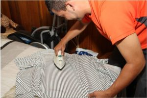 man ironing shirt not steam press